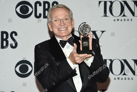 """Bob Mackie poses with the award for best costume design of a musical for """"The Cher Show"""" in the press room at the 73rd annual Tony Awards, in New York"""