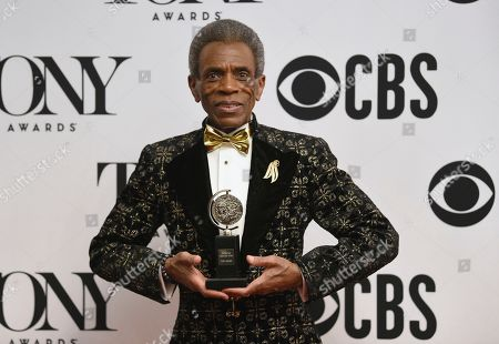 """Andre De Shields poses in the press room with the award for best performance by an actor in a featured role in a musical for """"Hadestown"""" at the 73rd annual Tony Awards, in New York"""