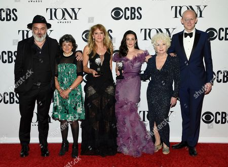 """Jez Butterworth, left, and the company of """"The Ferryman"""" pose in the press room with the award for best play at the 73rd annual Tony Awards, in New York"""