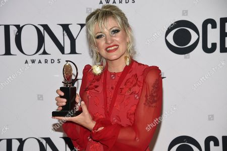 """Anais Mitchell poses in the press room with the award for best original score for """"Hadestown"""" at the 73rd annual Tony Awards, in New York"""
