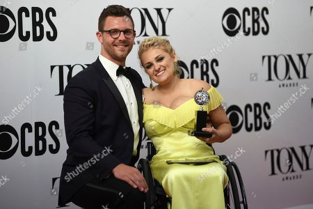 "David Perlow, Ali Stroker. David Perlow, left, joins Ali Stroker as she poses in the press room with the award for best performance by an actress in a featured role in a musical for ""Rodgers & Hammerstein's Oklahoma!"" at the 73rd annual Tony Awards, in New York"