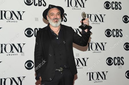 """Jez Butterworth poses in the press room with the award for best play for """"The Ferryman"""" at the 73rd annual Tony Awards, in New York"""