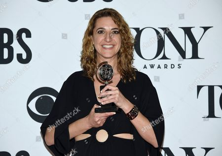 """Eva Price poses in the press room with the award for best revival of a musical for """"Rodgers & Hammerstein's Oklahoma!"""" at the 73rd annual Tony Awards, in New York"""
