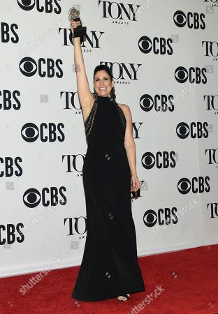 "Stephanie J. Block poses in the press room with the award for best performance by an actress in a leading role in a musical for ""The Cher Show"" at the 73rd annual Tony Awards, in New York"