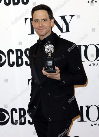 """Santino Fontana poses in the press room with the award for best performance by an actor in a leading role in a musical for """"Tootsie"""" at the 73rd annual Tony Awards in New York, New York, USA, 09 June 2019. The annual awards honor excellence in Broadway theatre."""