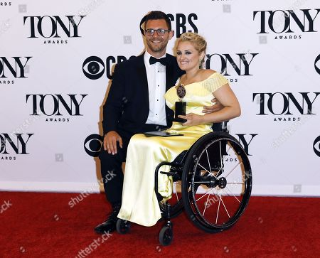 "David Perlow (L) joins Ali Stroker as she poses in the press room with the award for best performance by an actress in a featured role in a musical for ""Rodgers & Hammerstein's Oklahoma!"" at the 73rd annual Tony Awards in New York, New York, USA, 09 June 2019. The annual awards honor excellence in Broadway theatre"
