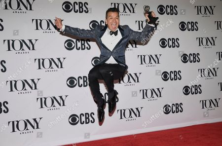 """Sergio Trujillo poses in the press room with the choreography award for"""" Ain't Too Proud ñ The Life and Times of the Temptations"""" at the 73rd annual Tony Awards, in New York"""