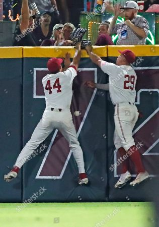 Christian Robinson, Brandon Wulff. Stanford's Christian Robinson (44) and Brandon Wulff (29) fail to catch the ball by Mississippi State's Dustin Skelton at the fence, which became a triple during the third inning in Game 2 at the NCAA college baseball super regional tournament in Starkville, Miss