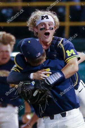 Michigan's Benjamin Keizer (14) and Michigan's Joe Donovan (0) celebrate after Michigan defeated UCLA during the ninth inning of an NCAA college baseball tournament super regional game in Los Angeles, . Michigan won 4-2