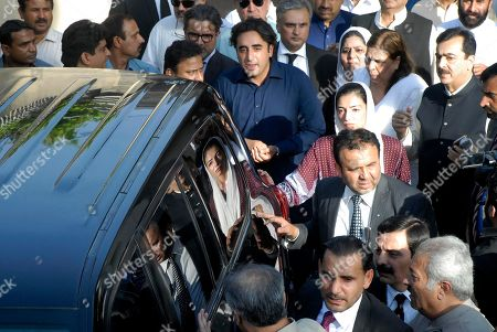 Pakistan's opposition leader Bilawal Bhutto Zardari, in blue shirt center, sees off his father Asif Ali Zardari, former President of Pakistan with other family members, at his residence in Islamabad, Pakistan, . Pakistan's anti-graft body on Monday arrested Zardari, widower of assassinated ex-Premier Benazir Bhutto, in a multi-million dollar money laundering case that has shaken the country