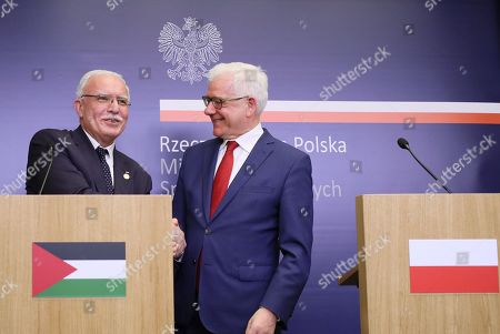 Polish Foreign Minister Jacek Czaputowicz (R) and Foreign Affairs Minister of the Palestinian National Authority Riyad al-Maliki (L) shake hands at a press conference after their meeting in Warsaw, Poland, 10 June 2019.