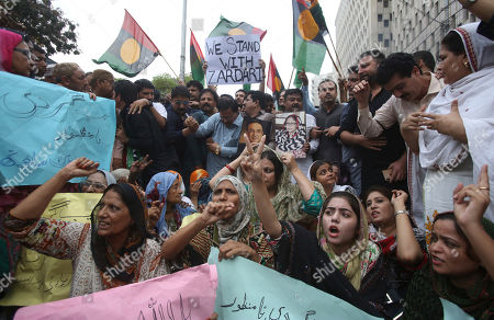 Supporters of Pakistan's former President Asif Ali Zardari protest to condemn his arrest, in Karachi, Pakistan, . Pakistan's anti-graft body on Monday arrested Zardari, widower of assassinated ex-Premier Benazir Bhutto, in a multi-million dollar money laundering case that has shaken the country