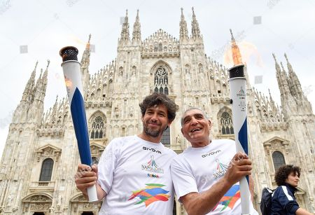 Former Italian boxer Patrizio Oliva (R) and former AC Milan player Demetrio Albertini, two of the torchbearers who took part in the third stage of the torch relay route of the 30th Summer Universiade Napoli 2019 in front of the cathedral in Milan, Italy, 10 June 2019. The 30th Summer Universiade will be held in Naples from 3 to 14 July.