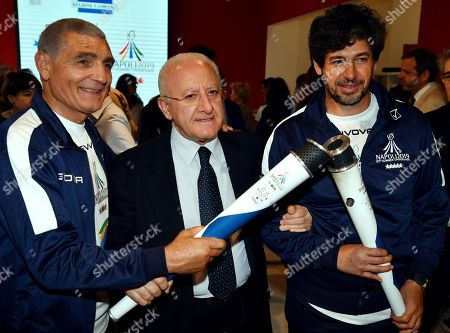 The president of the Campania Region, Vincenzo De Luca (C), poses for a photo with the torch with former Italian boxer Patrizio Oliva (L) and former AC Milan player Demetrio Albertini, two of the torchbearers who took part in the third stage of the torch relay route of the 30th Summer Universiade Napoli 2019 in Milan, Italy, 10 June 2019. The 30th Summer Universiade will be held in Naples from 3 to 14 July.