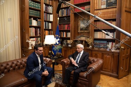 Stock Picture of Alexis Tsipras, Karolos Papoulias. Greek prime Minister Alexis Tsipras, left, meets with Greek President Karolos Papoulias in Athens, on Monday 10, 2019. Tsipras visited Greece's president to formally call for the dissolution of parliament and early elections on July 7, following his party's heavy defeat in European elections last month