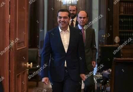 Alexis Tsipras, Karolos Papoulias. Greek prime Minister Alexis Tsipras, center, arrives to meet Greek President Karolos Papoulias, left, in Athens on . Tsipras visited Greece's president to formally call for the dissolution of parliament and early elections on July 7, following his party's heavy defeat in European elections last month