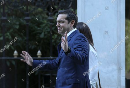 Alexis Tsipras, Karolos Papoulias. Greek Prime Minister Alexis Tsipras leaves from the Presidential Palace after his meeting with Greek President Karolos Papoulias, in Athens, on . Tsipras visited Greece's president to formally call for the dissolution of parliament and early elections on July 7, following his party's heavy defeat in European elections last month