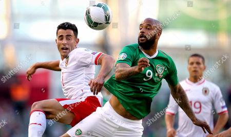 Republic of Ireland vs Gibraltar . Ireland's David McGoldrick and Alain Pons of Gibraltar