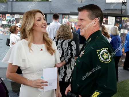 Barbara Poma, John Mina. Barbara Poma, left, CEO of the onePulse foundation, talks with Orange County Sheriff John Mina before a news conference to introduce legislation that would designate the Pulse nightclub site as a national memorial, in Orlando, Fla