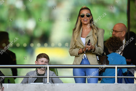 Claudine Keane wife of Robbie Keane looks on from the stands.