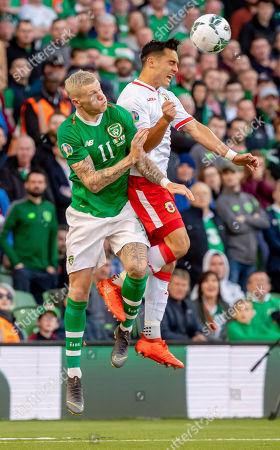 Republic of Ireland vs Gibraltar . Ireland's James McClean with John Sergeant of Gibraltar