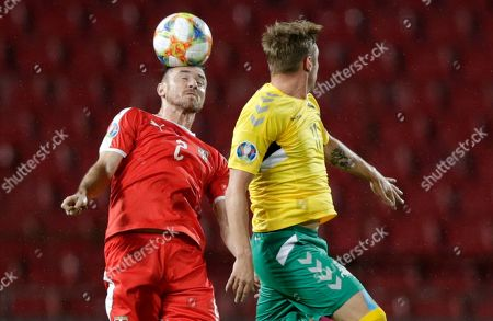Stock Photo of Serbia?s Antonio Rukavina (L) in action against Lithuania's Arvydas Novikovas (R) during the UEFA EURO 2020, Group B qualifying soccer match between Serbia and Lithuania, in Belgrade, Serbia, 10 June 2019.