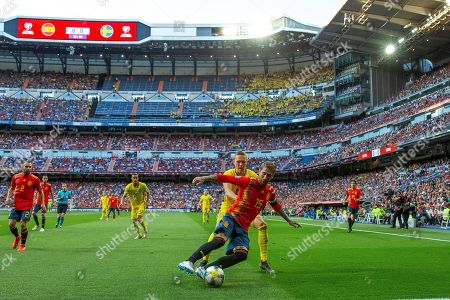 Spain's Sergio Ramos (C-R) in action against Sweden's Ludwig Augustinsson (C-L) during the UEFA EURO 2020 qualifying soccer match between Spain and Sweden at the Santiago Bernabeu stadium in Madrid, Spain, 10 June 2019.