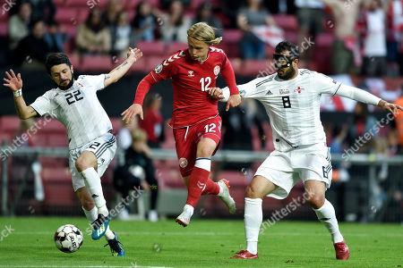 Denmark's Kasper Dolberg (C) vies for the ball with Georgia's Gija Grigalova (R) and Giorgi Navalovski (L) during the UEFA EURO 2020 qualifying soccer match between Denmark and Georgia in Telia Parken, Copenhagen, Denmark, 10 June 2019.