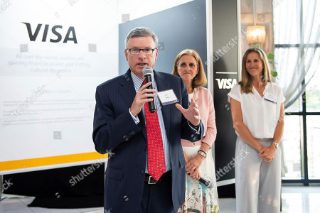 Visa's Chairman and CEO Al Kelly, joined by Visa's Executive Vice President and Chief Marketing Officer Lynne Biggar and soccer legend Brandi Chastain, welcomes attendees to a reception in Washington, D.C. celebrating the company's commitment to female empowerment on