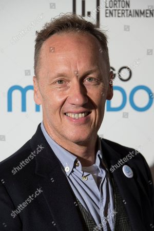 Lee Dixon poses for photographers upon arrival at the screening for 'Diego Maradona' in London