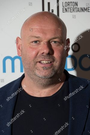 Paul Martin poses for photographers upon arrival at the screening for 'Diego Maradona' in London