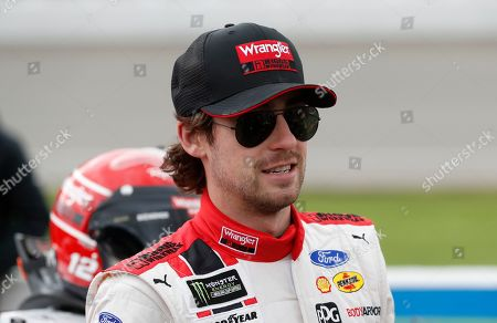 Ryan Blaney stands next to his car before the NASCAR cup series auto race at Michigan International Speedway, in Brooklyn, Mich