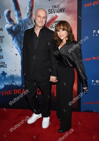 """Stock Image of Eric Haze, Rosie Perez. Actress Rosie Perez, right, and husband Eric Haze attend the premiere of """"The Dead Don't Die"""" at the Museum of Modern Art, in New York"""