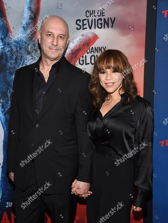 """Eric Haze, Rosie Perez. Actress Rosie Perez, right, and husband Eric Haze attend the premiere of """"The Dead Don't Die"""" at the Museum of Modern Art, in New York"""