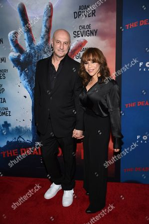 """Stock Photo of Eric Haze, Rosie Perez. Actress Rosie Perez, right, and husband, Eric Haze, attend the premiere of """"The Dead Don't Die,"""" at the Museum of Modern Art, in New York"""