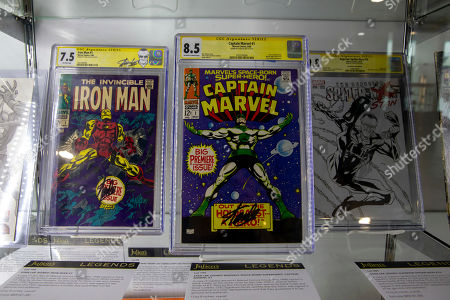 Stock Photo of Original comic books Iron Man #1 and Captain Marvel #1 signed by creator Stan Lee sit on display prior to the Legends auction at the Standard Oil Building in Beverly Hills, California, USA, 10 June 2019. The Legends auction will take place on 13 and 14 June 2019.