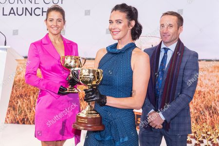 Australian jockeys Michelle Payne (L) and Damien Oliver (R) along with Australian model Megan Gale (C) pose for photographs with the 2019 Melbourne Cup (R) and the 1919 Melbourne Cup (L) during the Lexus Melbourne Cup 2019 Tour announcement at Flemington Racecourse in Melbourne, Australia, 11 June 2019. The Melbourne Cup is held on 05 November.