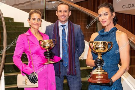 Australian jockeys Michelle Payne (L) and Damien Oliver (C) along with Australian model Megan Gale (R) pose for photographs with the 2019 Melbourne Cup (R) and the 1919 Melbourne Cup (L) during the Lexus Melbourne Cup 2019 Tour announcement at Flemington Racecourse in Melbourne, Australia, 11 June 2019. The Melbourne Cup is held on 05 November.