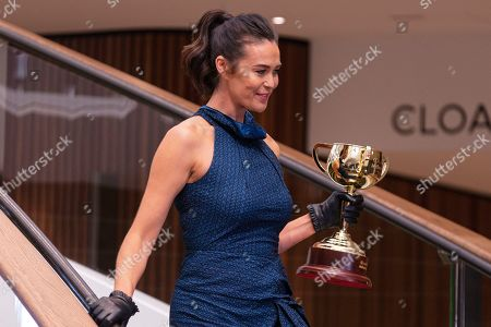 Stock Image of Australian modle Megan Gale arrives with the 2019 Melbourne Cup during the Lexus Melbourne Cup 2019 Tour announcement at Flemington Racecourse in Melbourne, Australia, 11 June 2019. The Melbourne Cup is held on 05 November.