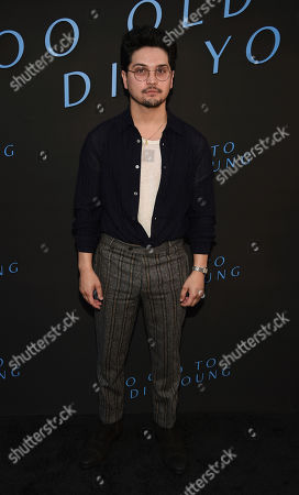 """Stock Image of Augusto Aguilera, a cast member in the Amazon Prime series """"Too Old to Die Young,"""" poses at a special screening of the show at the Vista Theatre, in Los Angeles"""