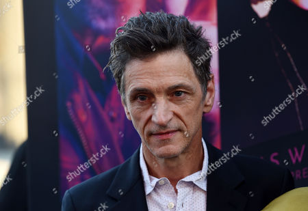 "John Hawkes, a cast member in ""Too Old to Die Young,"" poses at a special screening of the Amazon Prime series at the Vista Theatre, in Los Angeles"