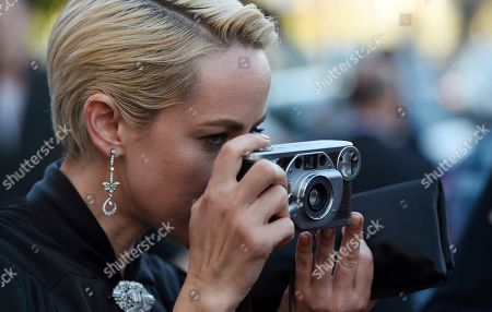 """Jena Malone, a cast member in the Amazon Prime series """"Too Old to Die Young,"""" takes a picture with her camera at a special screening of the show at the Vista Theatre, in Los Angeles"""