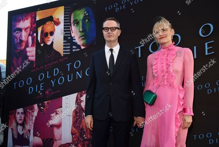 """Nicolas Winding Refn, Liv Corfixen. Nicolas Winding Refn, left, co-writer/director of the Amazon Prime series """"Too Old to Die Young,"""" poses with his wife Liv Corfixen at a special screening of the show at the Vista Theatre, in Los Angeles"""