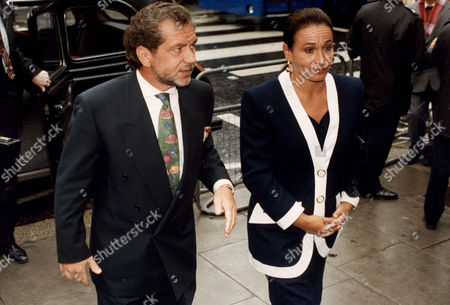 Editorial image of Sir Alan Sugar Baron Sugar Of Clapton Pictured With His Wife Lady Ann Sugar Arriving At The High Court In London.