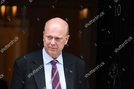 Chris Grayling, Secretary of State for Transport, leaves No.10 Downing Street