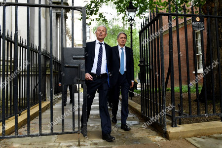 David Lidington, Minister for the Cabinet Office, and Philip Hammond, Chancellor of the Exchequer, arrive at No.10 Downing Street