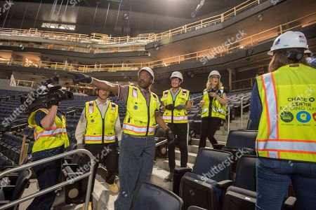 Stock Photo of Tim Hardaway, Golden State Warriors Legend, centre, celebrates the New Chase Center's Long-Term Official Ticketing and Technology Partnership with Ticketmaster on in San Francisco