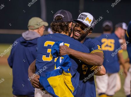 Los Angeles, CA..Michigan outfielder (5) Christian Bullock celebrates with (37) Karl Kauffmann after the Wolverines advance to the college world series following an NCAA super regional game between the Michigan Wolverines and the UCLA Bruins at Jackie Robinson Stadium in Los Angeles, California. Michigan defeated UCLA 4-2. .(Mandatory Credit: Juan Lainez / MarinMedia.org / Cal Sport Media)