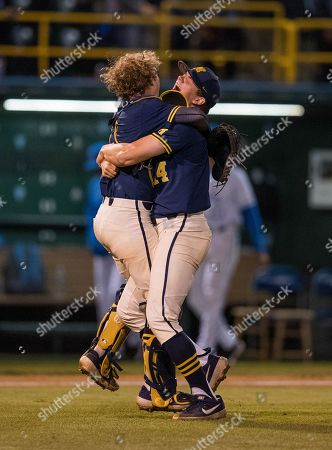 Los Angeles, CA..Michigan pitcher (47) Ben Keizer celebrates with his teammate (0) Joe Donovan after the Wolverines advance to the college world series following an NCAA super regional game between the Michigan Wolverines and the UCLA Bruins at Jackie Robinson Stadium in Los Angeles, California. Michigan defeated UCLA 4-2. .(Mandatory Credit: Juan Lainez / MarinMedia.org / Cal Sport Media)