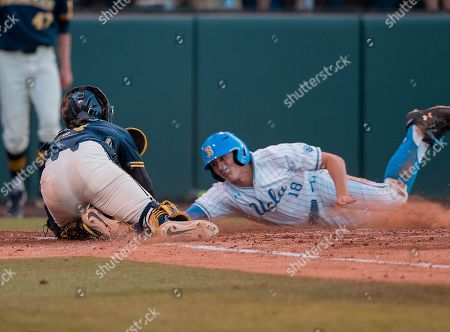 Los Angeles, CA..Michigan catcher (0) Joe Donovan tags out (18) Jeremy Ydens from UCLA at home plate during an NCAA super regional game between the Michigan Wolverines and the UCLA Bruins at Jackie Robinson Stadium in Los Angeles, California. Michigan defeated UCLA 4-2. .(Mandatory Credit: Juan Lainez / MarinMedia.org / Cal Sport Media)